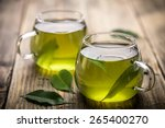 Stock photo fresh green tea with tea leaves in the water 265400270