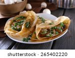 pancakes with creamy mushrooms... | Shutterstock . vector #265402220