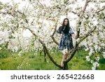 spring walk girl in a beautiful ... | Shutterstock . vector #265422668