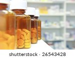 row of bottles and pills on a chemists counter - stock photo