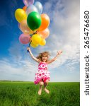 happy child jumping with... | Shutterstock . vector #265476680