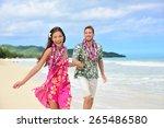 happy couple having fun running ... | Shutterstock . vector #265486580