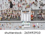 Small photo of MILAN, ITALY - MARCH 29, 2015: the Wall of Dolls, a symbolic accusal against the murder of women, a violation of the human rights. Sympathy can be expressed by leaving a doll on the wall