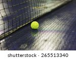 tennis ball and net on wet... | Shutterstock . vector #265513340