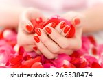 female hands with red nails... | Shutterstock . vector #265538474