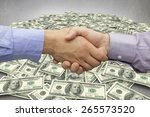 hand shake in front of wires... | Shutterstock . vector #265573520