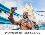 smiling black man taking selfie ... | Shutterstock . vector #265582739