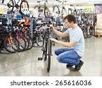 Man Checks A Bike Before Buying ...