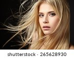 Portrait Of Blonde Girl With...