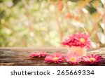 Pink Flowers In A Basket On A...