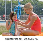 mother and daughter at the pool | Shutterstock . vector #26568976