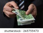man in black suit counts euro... | Shutterstock . vector #265755473