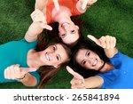 three happy teenage girls... | Shutterstock . vector #265841894