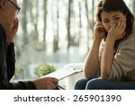 young depressed woman taking... | Shutterstock . vector #265901390