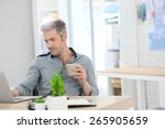 relaxed man working form home... | Shutterstock . vector #265905659