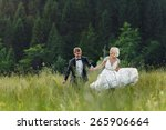 wedding couple running on green ... | Shutterstock . vector #265906664