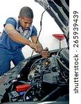 good looking mechanic working... | Shutterstock . vector #265939439