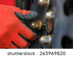 close up photo of wheel change | Shutterstock . vector #265969820