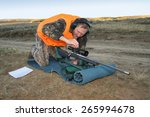 rifle hunter adjusting rifle... | Shutterstock . vector #265994678