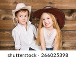 Cowboy And Cowgirl Kid Smiling...
