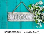 Wooden Welcome Sign With Sprin...