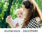mother and the daughter in park.... | Shutterstock . vector #266109680