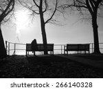 Depressed Woman Sitting Alone...