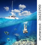 Girl Diving In Ocean With...