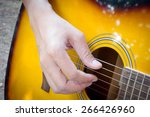 hand playing acoustic guitar ... | Shutterstock . vector #266426960