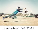 boy leaping to catch a baseball | Shutterstock . vector #266449550