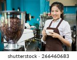 coffee shop owner holding a... | Shutterstock . vector #266460683