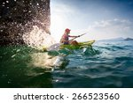 young lady paddling hard the... | Shutterstock . vector #266523560