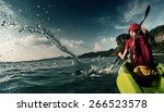 young lady paddling hard the... | Shutterstock . vector #266523578