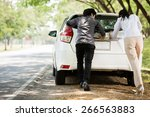 couple helped us push the car.... | Shutterstock . vector #266563883