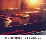 chocolate cake in oven with...