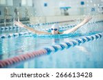 young woman in goggles and cap... | Shutterstock . vector #266613428