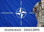 US soldier on a Nato flag background - stock photo