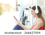 Woman Listening To The Music...