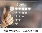 business hand clicking quality... | Shutterstock . vector #266635448