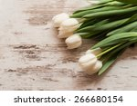White Tulips On A Wooden...