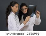 two young nurses analyzing a... | Shutterstock . vector #2666999