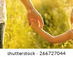 hand of parent and child | Shutterstock . vector #266727044