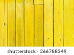Old Wooden Fence With Yellow...