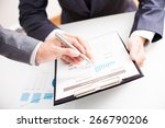 two businessmen looking at... | Shutterstock . vector #266790206