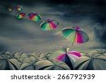 rainbow umbrella in the mass of ... | Shutterstock . vector #266792939