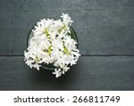 Stock photo white hyacinth flowers on black wooden table 266811749