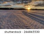 Snowmobile Tracks Heading Into...