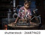 boy mechanic looks like two... | Shutterstock . vector #266874623