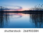 beautiful sunset over calm lake.... | Shutterstock . vector #266903384