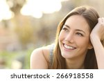 woman with white teeth thinking